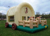 14 X 21 Wild West Bouncer with inflatable horses on front Add inflatable pony hops for $25 each (must be ridden on grass or inside gym floor)