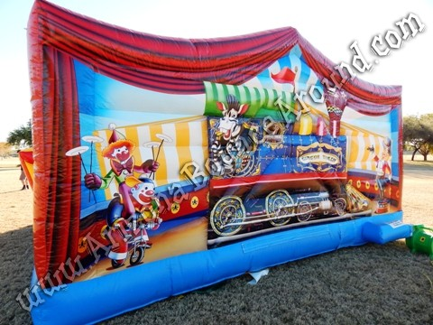 This is the back wall of the circus themed bounce house with a train ...
