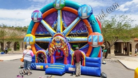 4 & 1 Ferris Wheel Bounce House Rental with slide and obstacles